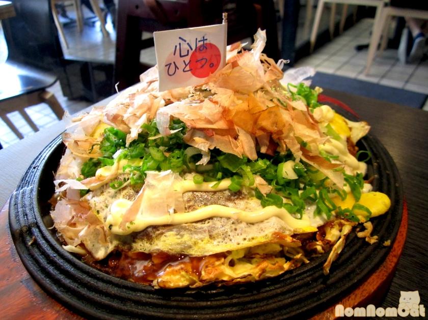 Gottsui Okonomiyaki - the flag says Kokoro wa Hitotsu, or One Heart.