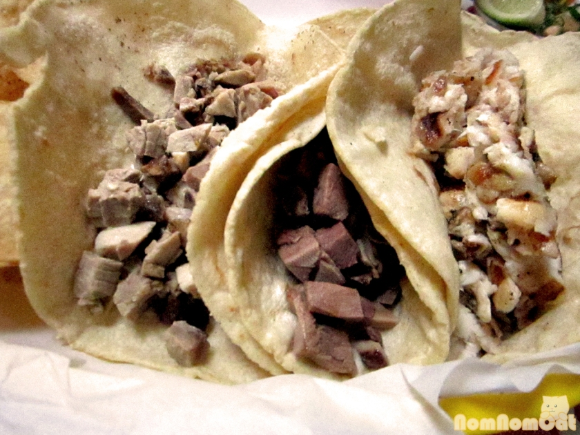 Tacos. (From left to right: Carnitas, Lengua, and Pescado)