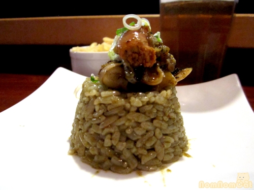 """Dirty Rice"" made from the hinge muscle and innards of the scallop"
