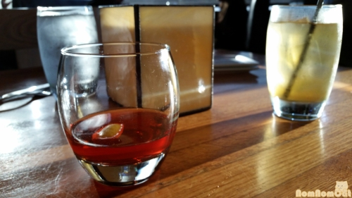 Foreground: Sazerac Old Overholt Rye Whiskey | Simple Syrup | Bitters | Absinthe Mist (Background: Iced Green Tea)