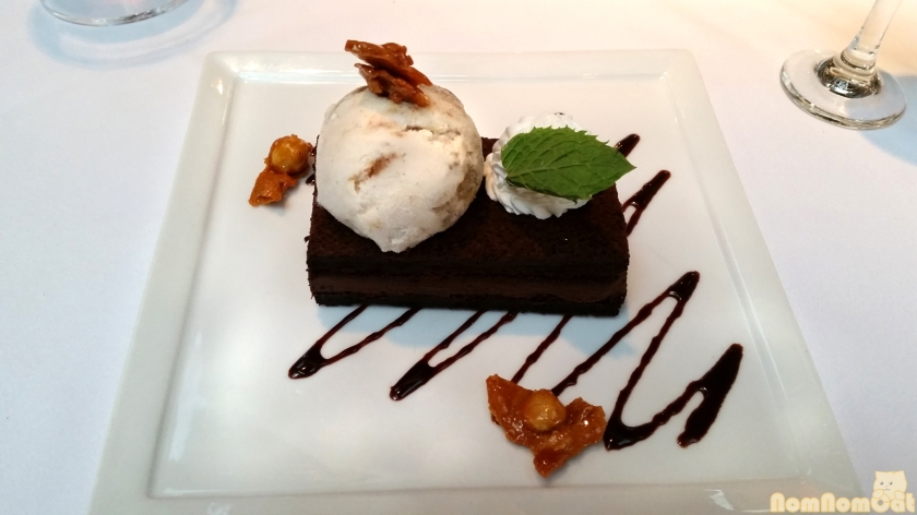 Flourless Chocolate Cake | Caramelized Banana Gelato, Hazelnuts.